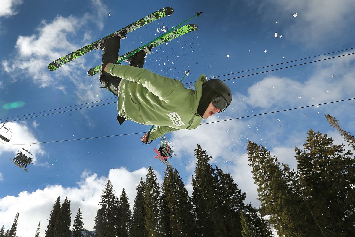 FILE - Daniel Brown does a backflip during opening day at Brighton Ski Resort on Tuesday, Nov. 21, 2017.