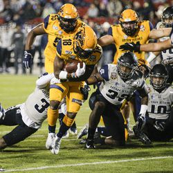 Kent State running back Xavier Williams (18) scores a touchdown as Utah State safety Troy Lefeged Jr. (3) defends during the first half of the Frisco Bowl NCAA college football game Friday, Dec. 20, 2019, in Frisco, Texas.