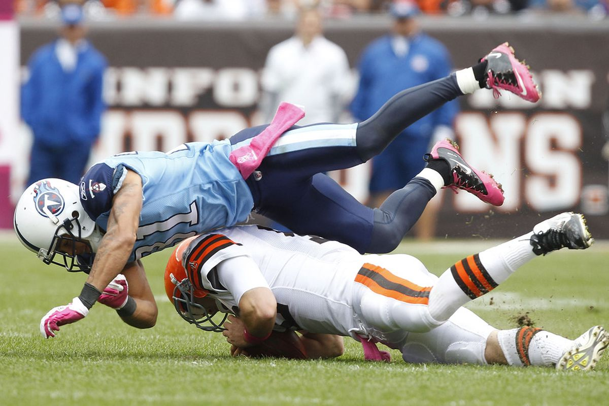 CLEVELAND, OH - OCTOBER 02:  Cornerback Cortland Finnegan #31 of the Tennessee Titans hits quarterback Colt McCoy #12 of the Cleveland Browns at Cleveland Browns Stadium on October 2, 2011 in Cleveland, Ohio.  (Photo by Matt Sullivan/Getty Images)