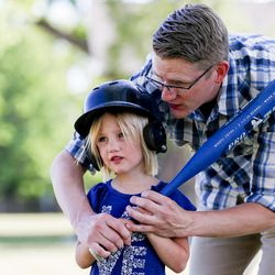 Alex Jensen instructs his daughter Olivia Jensen, 5, how to hit, at Edgemont South Stake Park in Provo on Tuesday, May 30, 2017.