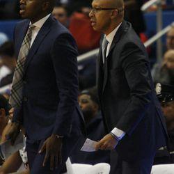 UConn assistant coach Dwayne Killings & Raphael Chillious watch play on the defensive end.
