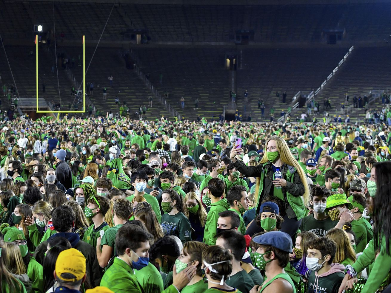 Fans storm the field after Notre Dame defeated the Clemson 47-40 in two overtimes in an NCAA college football game Saturday, Nov. 7, 2020, in South Bend, Ind.