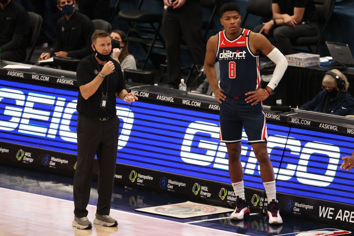 Head coach Scott Brooks and Rui Hachimura of the Washington Wizards look on against the Phoenix Suns during the first half at Capital One Arena on January 11, 2021 in Washington, DC.