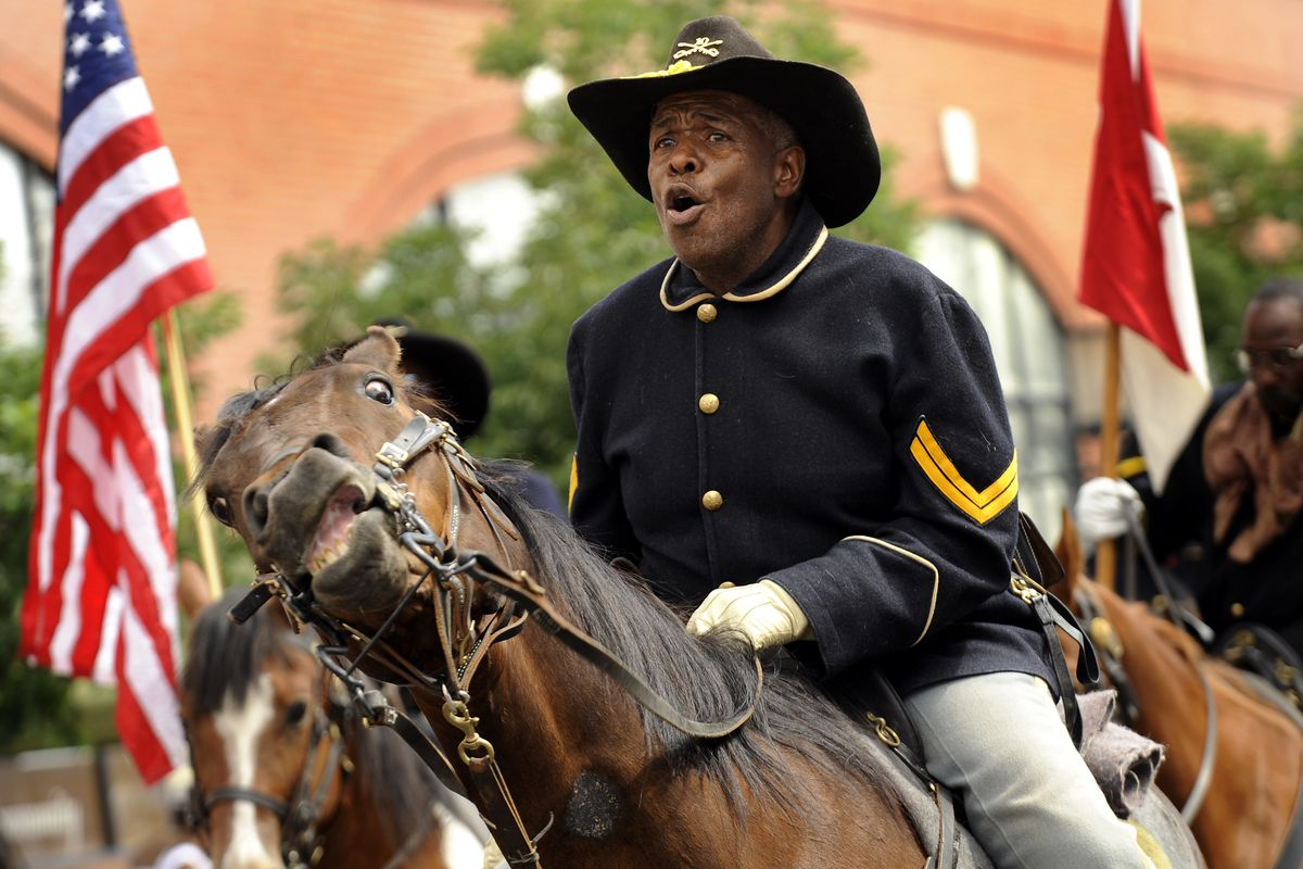 Jonas Felix leads the Buffalo Soldiers of the American West during the Juneteenth Parade, in the historic Five Points neighborhood, in Denver, CO. The parade kicked off a daylong festival and celebration. Juneteenth is the oldest nationally celebrated com
