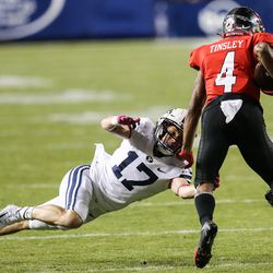 Brigham Young Cougars linebacker Matthew Criddle (17) attempts to stop Western Kentucky Hilltoppers wide receiver Mitchell Tinsley (4) during an NCAA football game at LaVell Edwards Stadium in Provo on Saturday, Oct. 31, 2020.