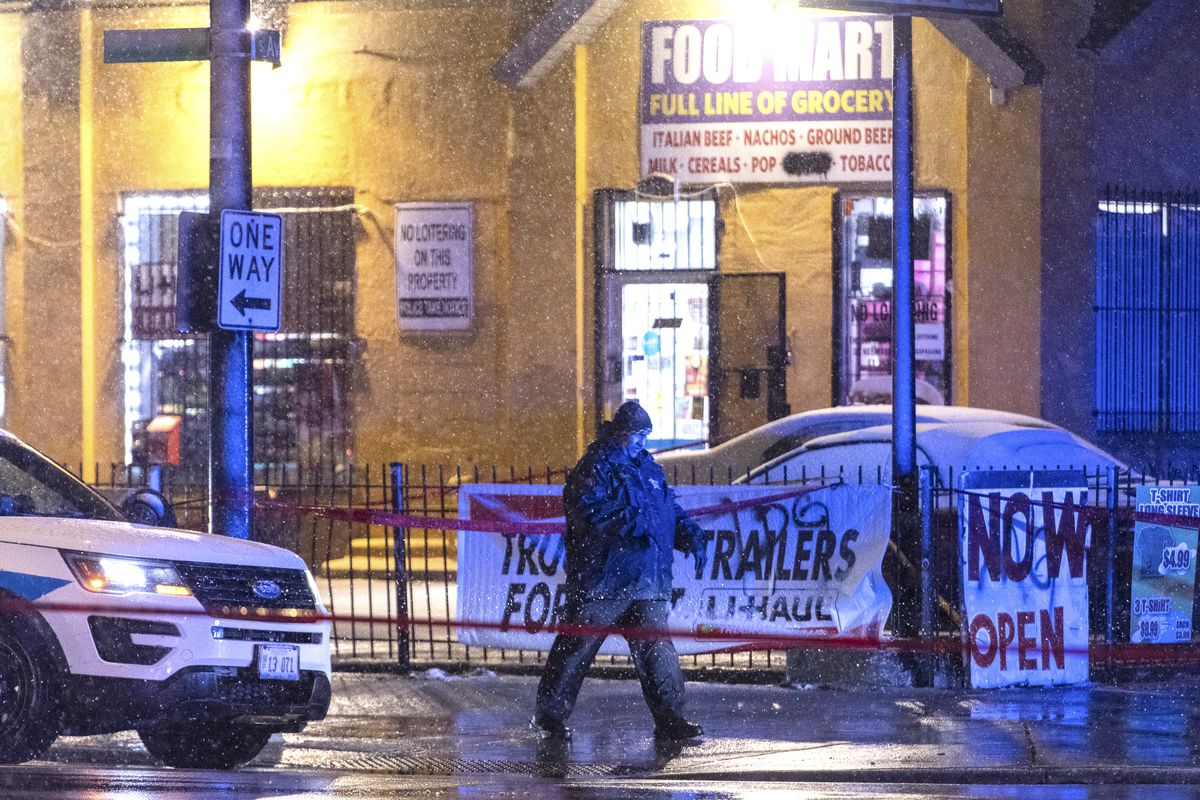Chicago police investigate the scene where multiple people were shot and one was killed in the 7900 block of South Avalon, Tuesday, Feb. 25, 2020.