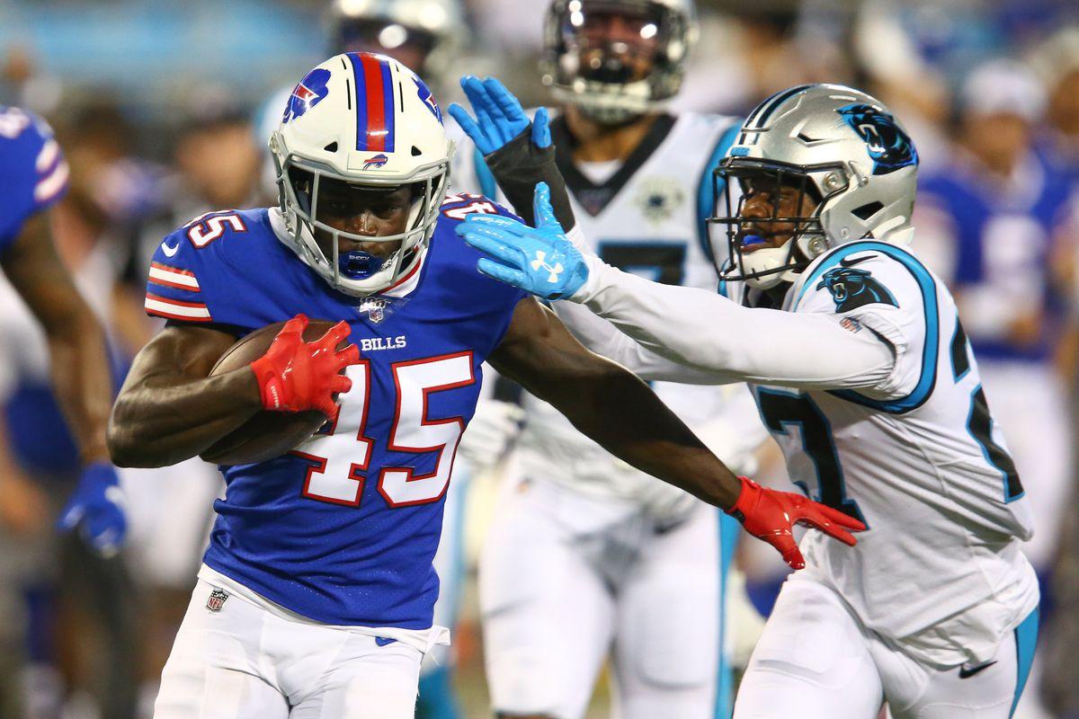 Buffalo Bills running back Christian Wade tries to avoid the tackle of Carolina Panthers cornerback Josh Thornton during the fourth quarter at Bank of America Stadium.