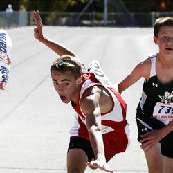 Yanni Gallagher, left, of Kanab, lunges at the finish line to take first place ahead of Ryan Westermann of Rowland Hall in the boys 2A state cross country high school competition at Sugarhouse Park in Salt Lake City, Wednesday, Oct. 19, 2011.