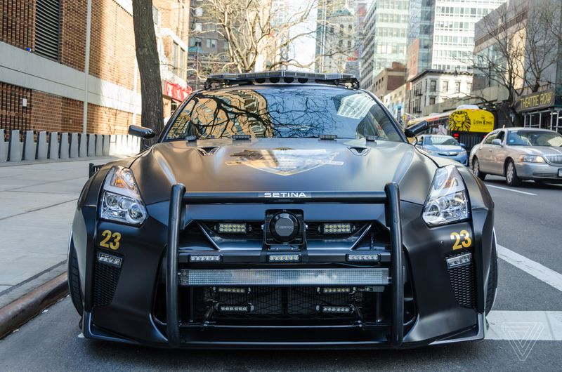 This Nissan GTR looks like the evil cop car from Transformers