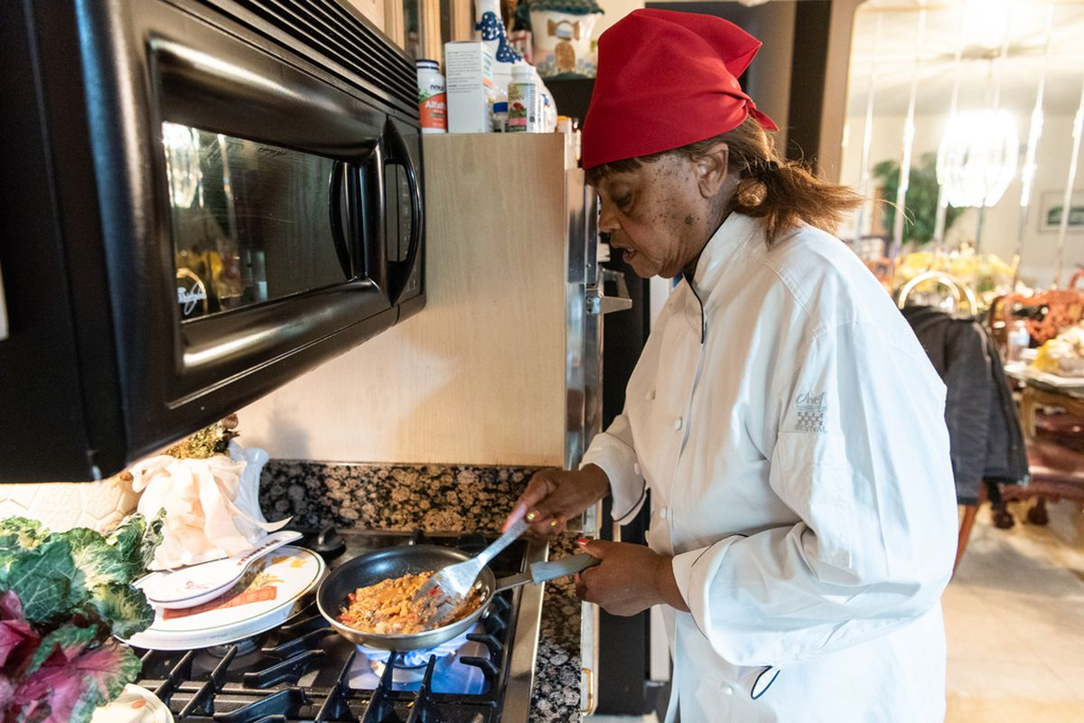 """Josephine """"Mother"""" Wade, owner of Josephine's Southern Cooking in the Chatham neighborhood, prepares a simple nacho dish at her home kitchen, Monday, Feb. 3, 2020, in Chicago."""