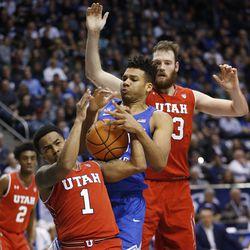 Brigham Young Cougars forward Yoeli Childs (23) battles Utah Utes guard Justin Bibbins (1) for the ball in Provo on Saturday, Dec. 16, 2017. BYU won 77-65.
