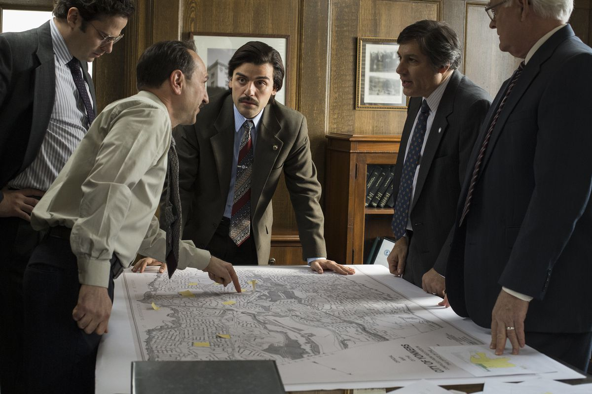 Mayor Nick Wasicsko (Oscar Isaac, center) goes over plans for new housing projects in Yonkers in the miniseries Show Me a Hero.