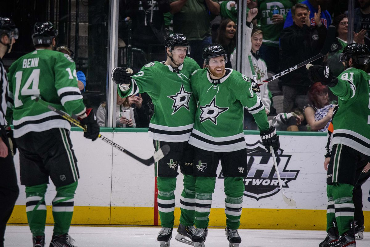 Dallas Stars left wing Jamie Benn and defenseman John Klingberg and center Joe Pavelski and center Tyler Seguin celebrates a goal scored by Klingberg against the Edmonton Oilers during the third period at the American Airlines Center.