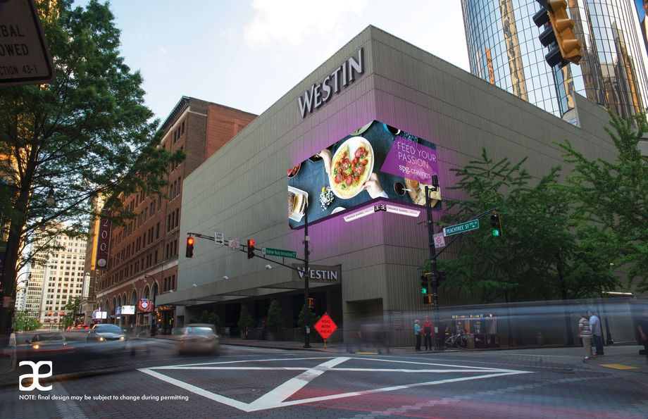 A Westin hotel show in downtown Atlanta with an LED billboard in purple.