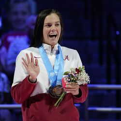 Rhyan White smiles during the medal ceremony for the women's 200 backstroke during wave 2 of the U.S. Olympic Swim Trials on Saturday, June 19, 2021, in Omaha, Neb.