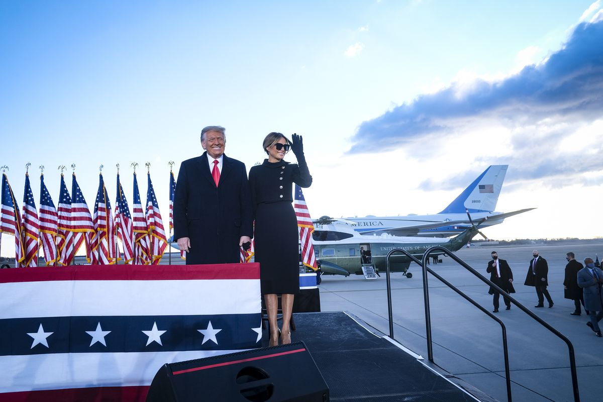 President Donald Trump and first lady Melania Trump arrive to speak to supporters prior to boarding Air Force One to head to Florida.