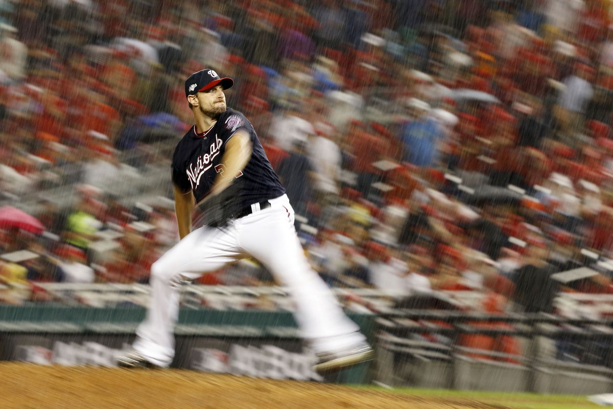 Washington Nationals starting pitcher Max Scherzer pitches during the seventh inning against the Los Angeles Dodgers in game four of the 2019 NLDS playoff baseball series at Nationals Park.