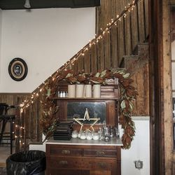 These original stairs lead up to a second floor loft space, which will eventually be used for private parties.