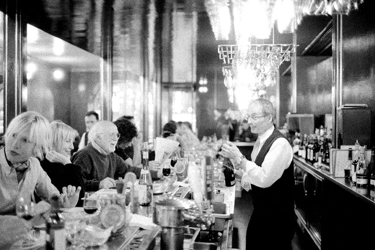 Claude Masson behind the bar at L'Express