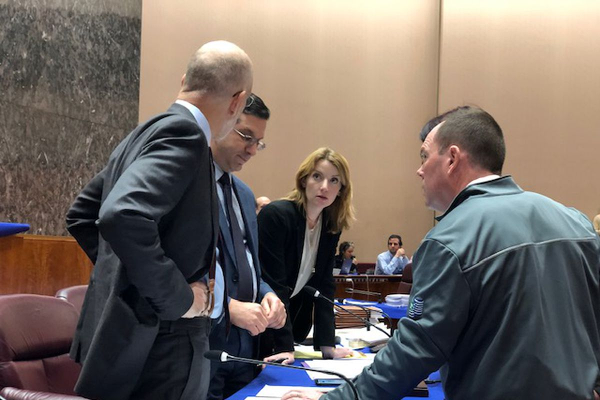 Finance Committee Chairman Scott Waguespack (32nd) (second from left) and Deputy Corporation Counsel Jeff Levine (far left) huddle with Ald. Matt O'Shea (19th) (right) during a brief recess at Tuesday's Finance Committee meeting.