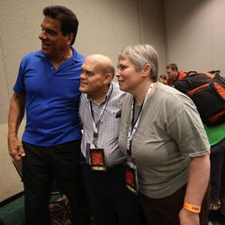 """Lou Ferrigno, who plays the Hulk in """"The Incredible Hulk,"""" takes a photo with Melvin Farr and Melissa Farr during a press conference at Utah's first Comic Con at the Salt Palace Convention Center in Salt Lake City on Thursday, Sept. 5, 2013."""