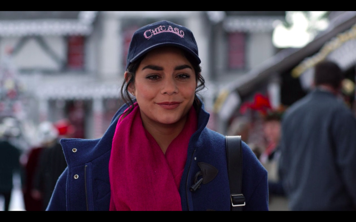 """Stacy looking straight ahead, wearing a navy baseball cap with """"CHICAGO"""" printed on it in red letters"""