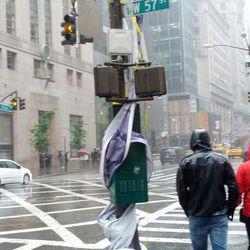 "One of Bergdorf's purple birthday streamers, now wrapped around a pole, via <a href=""https://twitter.com/JamesMartinSJ/status/263291728985997312"">@JamesMartinSJ</a>/Twitter"