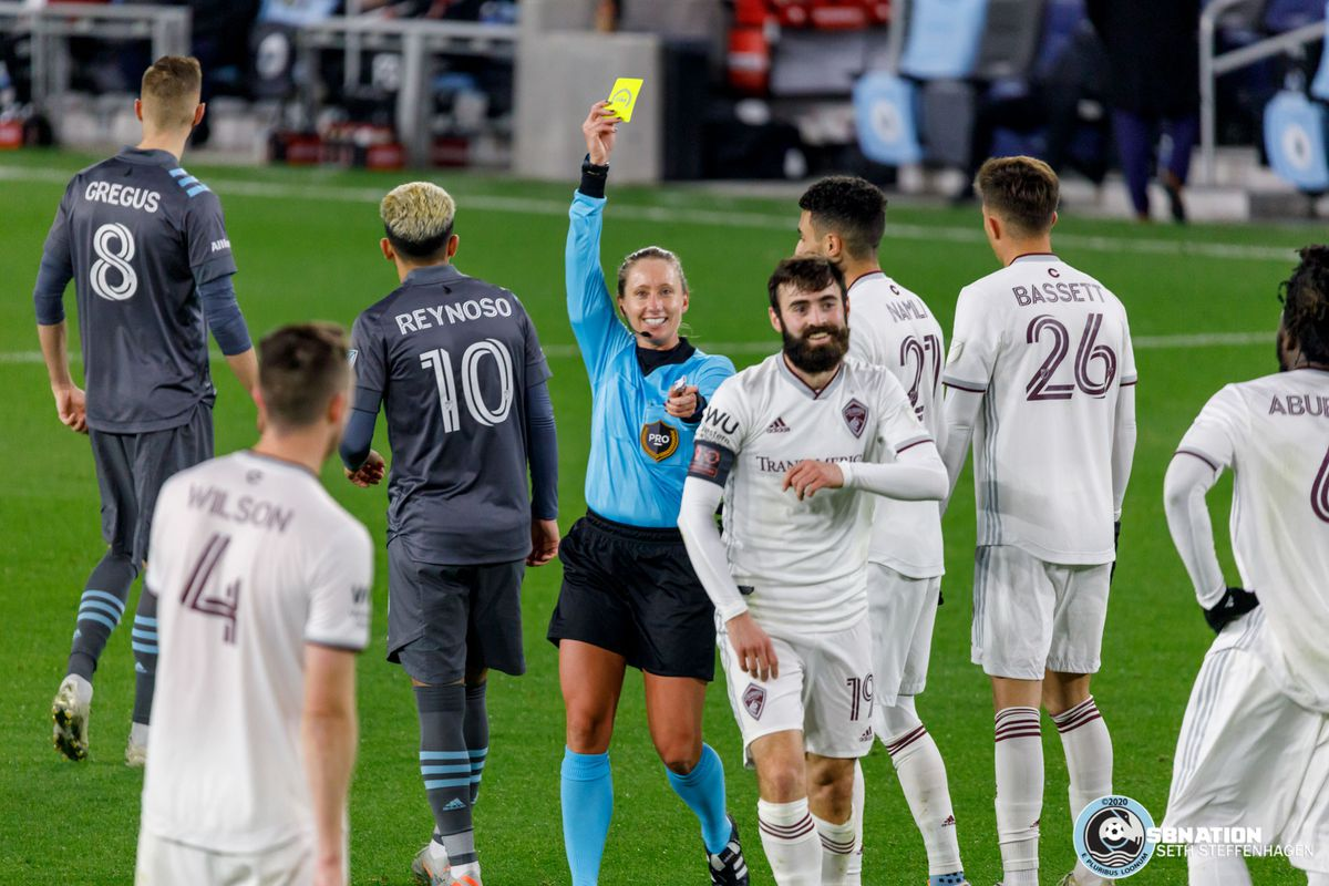 October 28, 2020 - Saint Paul, Minnesota, United States - Referee Tori Penso laughs off the response by Colorado Rapids midfielder Jack Price (19) after issuing him a yellow card during the Minnesota United vs Colorado Rapids match at Allianz Field.