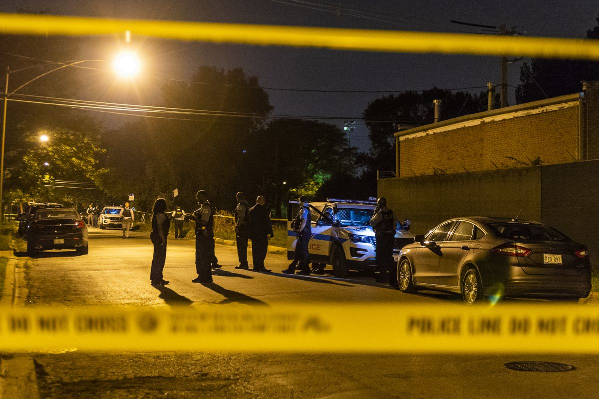 Chicago Police investigate two boys found shot dead Sunday night in the 13100 block of South Rhodes. | Tyler LaRiviere/Sun-Times