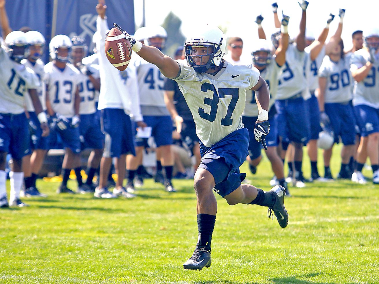 Utah State defensive back Devin Centers celebrates an interception to the cheers of his teammates during fall camp in Logan in 2016. A recent NCAA proposal for an extended preseason has been finalized and is expected to be approved, but no one knows exactly what it will look like.
