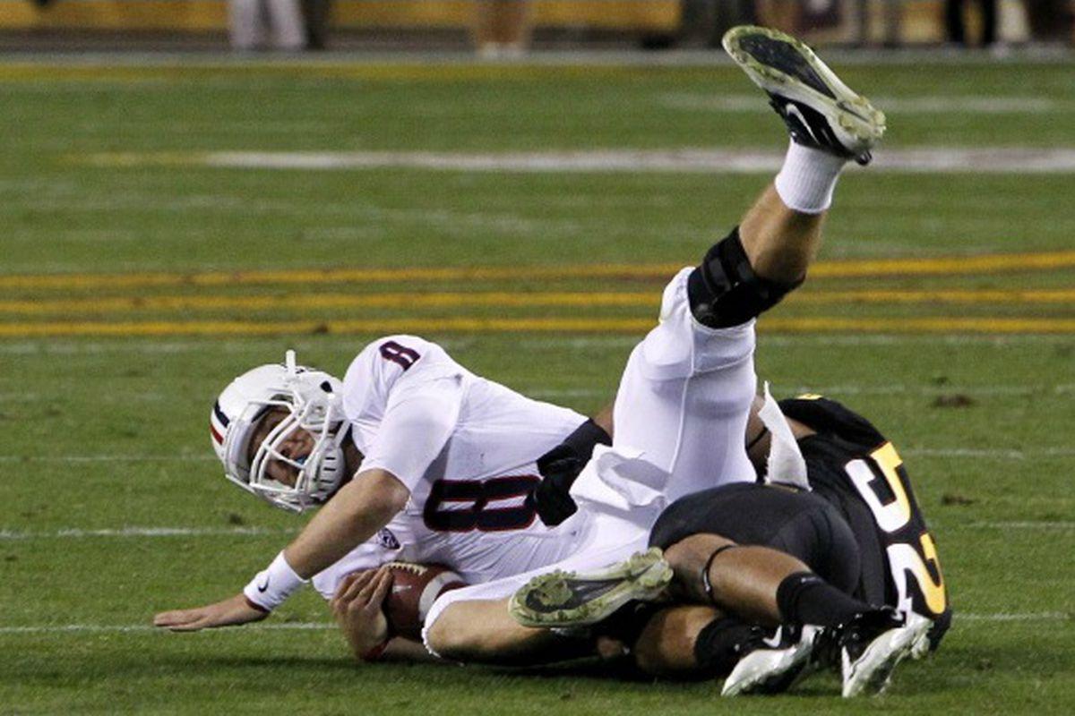 Carl Bradford takes down Nick Foles (Photo: ASU)
