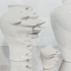 "Fast Medium Porcelain Vase, <a href=""http://jungleeny.com/fast-porcelain-vase.html"">$190</a>, Fast White Porcelain Mini Vase, <a href=""http://jungleeny.com/fast-white-mini-vase.html"">$35</a>"