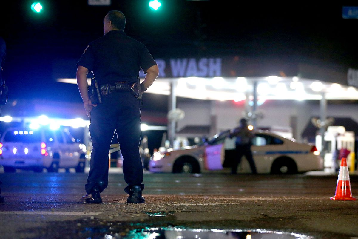 A police officer stands watch in Baton Rouge, Louisiana.