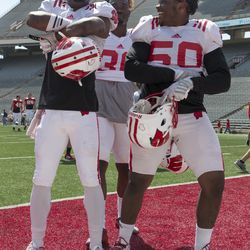 Three Badgers pose for fun after the scrimmage