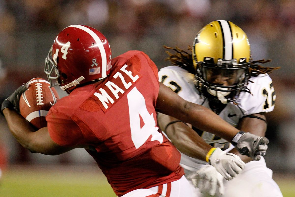 TUSCALOOSA, AL - OCTOBER 08:  Marquis Maze #4 of the Alabama Crimson Tide breaks a tackle by Steven Clarke #12 of the Vanderbilt Commodores at Bryant-Denny Stadium on October 8, 2011 in Tuscaloosa, Alabama.  (Photo by Kevin C. Cox/Getty Images)