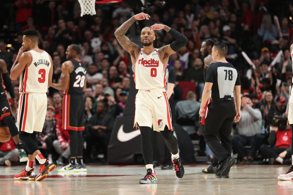 Portland Trail Blazers guard Damian Lillard reacts after making a shot and was fouled by the Miami Heat in the second half at Moda Center.