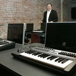 In this photo taken, Thursday, Aug. 6, 2009, director Scott Booker is pictured with production computers in a classroom at the Oklahoma City campus of the Academy of Contemporary Music in Oklahoma City.