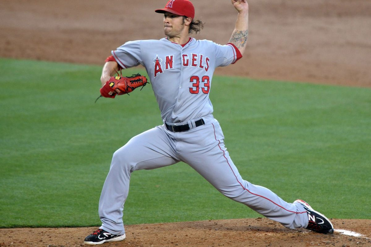Jun 13, Los Angeles, CA, USA; Los Angeles Angels starter C.J. Wilson (33) delivers a pitch against the Los Angeles Dodgers at Dodger Stadium. Mandatory Credit: Kirby Lee/Image of Sport-US PRESSWIRE