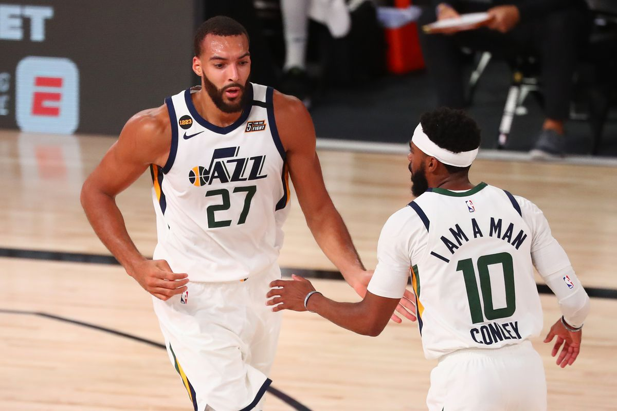 Utah Jazz center Rudy Gobert celebrates with guard Mike Conley after dunking against the Denver Nuggets during the first half of game seven of the first round of the 2020 NBA Playoffs at ESPN Wide World of Sports Complex.