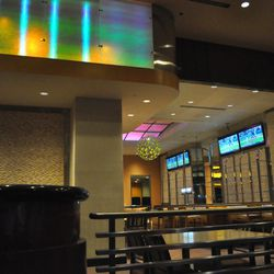 TV screens have been added behind a bar.