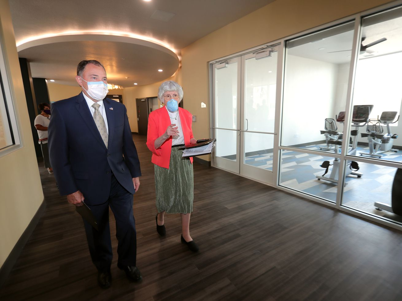 Gov. Gary Herbert, left, and Pamela Atkinson visit during a ribbon-cutting ceremony for Pamela's Place Apartments in Salt Lake City on Tuesday, Sept. 15, 2020. The Housing Authority of Salt Lake City newest, permanent supportive housing development is named after Atkinson, a longtime community advocate for people experiencing homelessness.