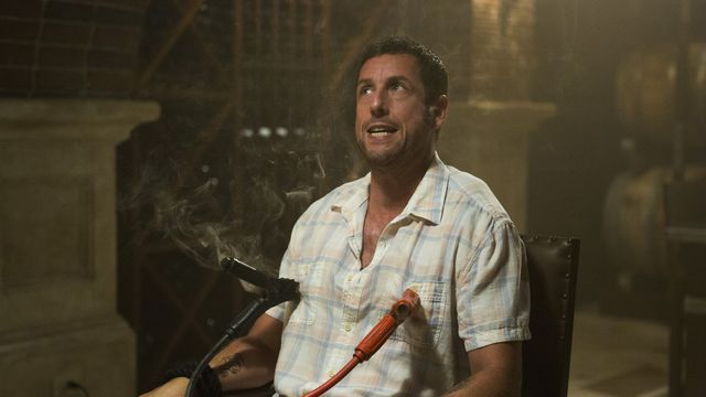 Adam Sandler strapped to a chair with car wires on his nipples in The Do-Over