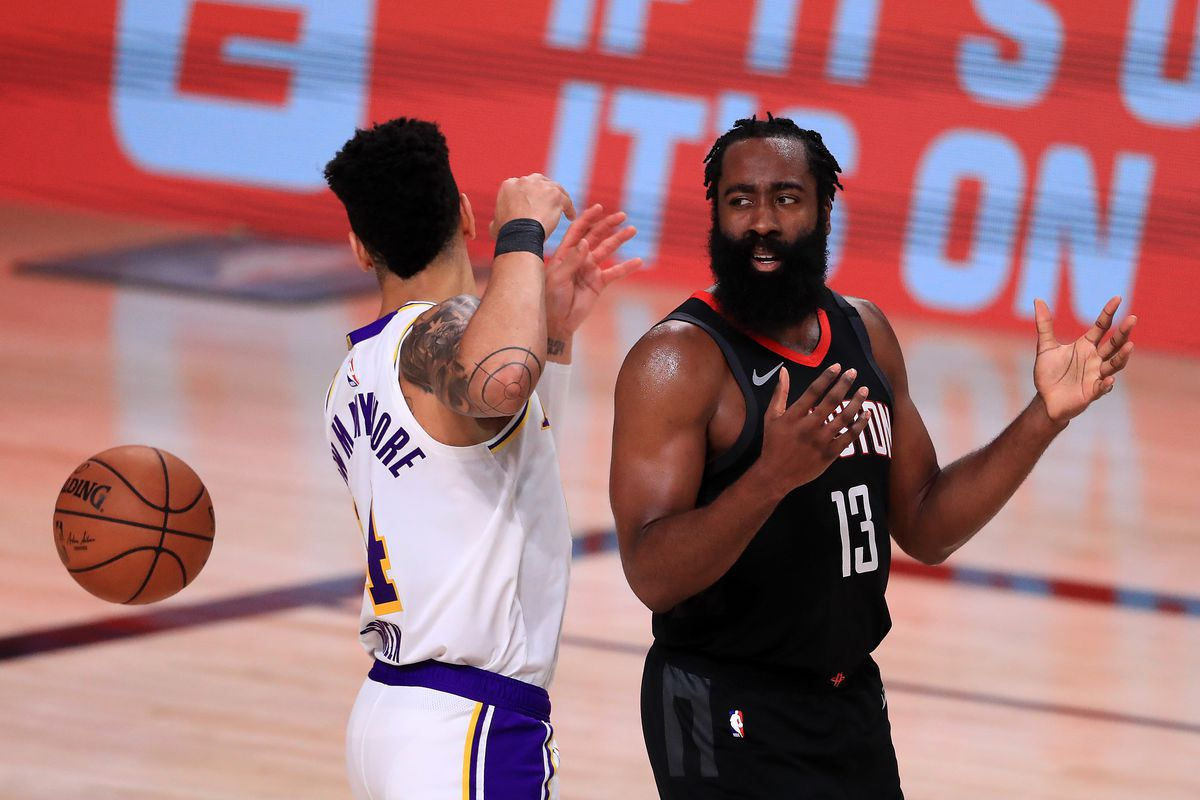 James Harden of the Houston Rockets reacts with Danny Green of the Los Angeles Lakers during the third quarter in Game Five of the Western Conference Second Round during the 2020 NBA Playoffs at AdventHealth Arena at the ESPN Wide World Of Sports Complex on September 12, 2020 in Lake Buena Vista, Florida.