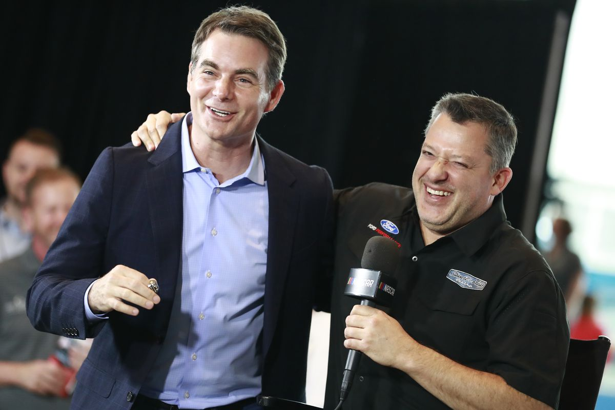 Class member 2019 Jeff Gordon and 2020 class member Tony Stewart embrace during the NASCAR 2020 Hall of Fame announcement ceremony at the NASCAR Hall of Fame on May 22, 2019 in Charlotte, North Carolina.