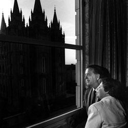 Myron and Olene Walker, who spent their honeymoon at Hotel Utah 33 years ago, enjoy a final sunset at hotel window on Aug. 31, 1987.