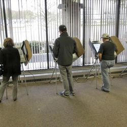 People vote during early voting for the 2016 General Election at the Salt Lake County Government Center on Tuesday, Nov. 1, 2016, in Salt Lake City. (AP Photo/Rick Bowmer)