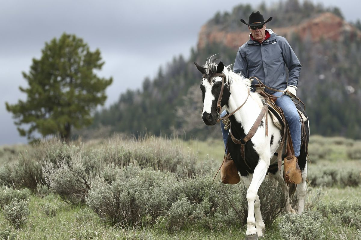 FILE - In this May 9, 2017, file photo, Interior Secretary Ryan Zinke rides in the Bears Ears National Monument with local and state representatives in Blanding, Utah. Zinke is strongly disputing a claim by outdoor retailer Patagonia that President Donald