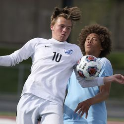 Stansbury's Max Rouffignac and Sky View's Taten Merrill go for the ball during the 4A boys soccer semifinals at Jordan High School in Sandy on Monday, May 17, 2021. Stansbury won in a shoot-out after double overtime.