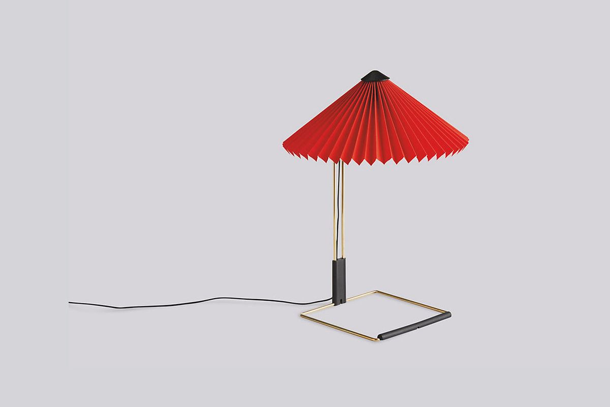 Lamp with square framed base and red pleated shade.