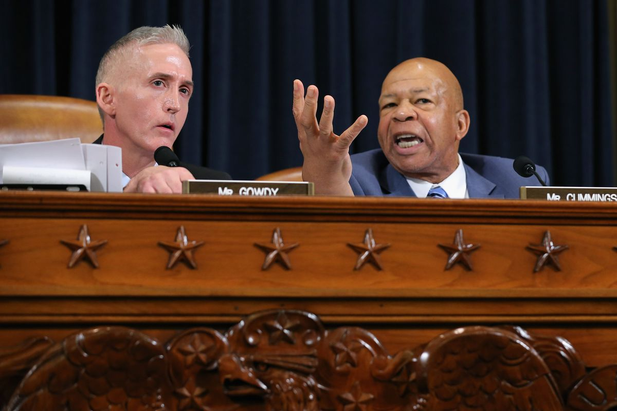House Select Committee on Benghazi Chairman Trey Gowdy (R-SC) (L) and ranking member Rep. Elijah Cummings (D-MD) argue during a hearing where Democratic presidential candidate and former Secretary of State Hillary Clinton testifies October 22, 2015 o